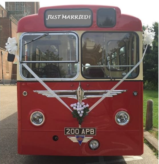 Vintage Wedding Bus with ribbons and flowers